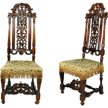 A fine pair of William III carved walnut chairs. England, c.1700.