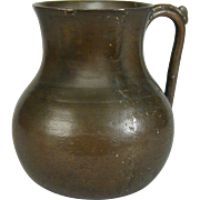 An unusual seventeenth century bronze drinking vessel.