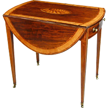 Sheraton mahogany oval pembroke table with satinwood crossbanding. England, c.1790