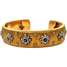 Signed M. Buccellati Gold Bracelet is Adorned with nine round cut Blue Sapphires 1.64 Carats Size 7
