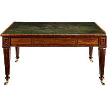 A Regency well-figured mahogany writing table