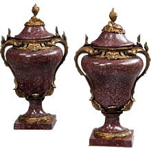 A pair of Egyptian Royal porphyry urns and covers