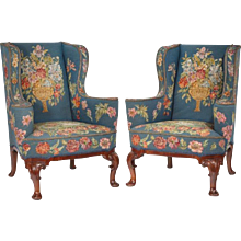 A Pair of Queen Anne style mahogany wing armchairs (England, c. 1915)