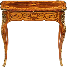 An unusual and attractive early Victorian kingwood, bird's eye maple and boxwood writing table