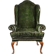 A George I walnut wing armchair of generous proportions