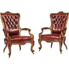 A Pair of large Victorian walnut arm chairs