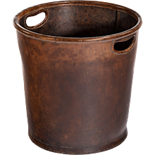An Edwardian leather paper bucket