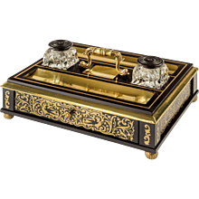 A Regency brass-inlaid ebony desk compendium