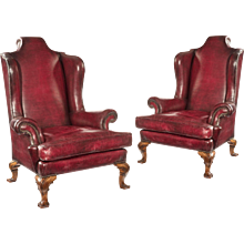 A wonderful pair of George II style walnut cabriole legged wing arm chairs