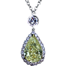 Micro pave pendant with a fancy yellow diamond