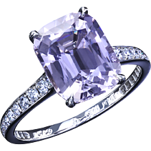 Cushion Capri spinel in a classic platinum ring with diamonds