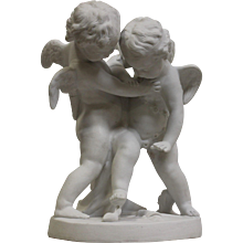 19th Century Sèvres white porcelaine group of two Cupids  fighting over a heart after Falconet