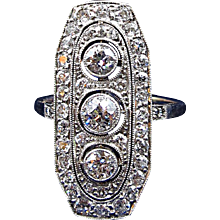 Fabulous Art Deco Knuckle-To-Knuckle Ring with 3 Center Diamonds @ 1.30 cttw another .90  in smaller diamonds totalling 2 ct overall size 9.5 in Platinum over 18K Gold